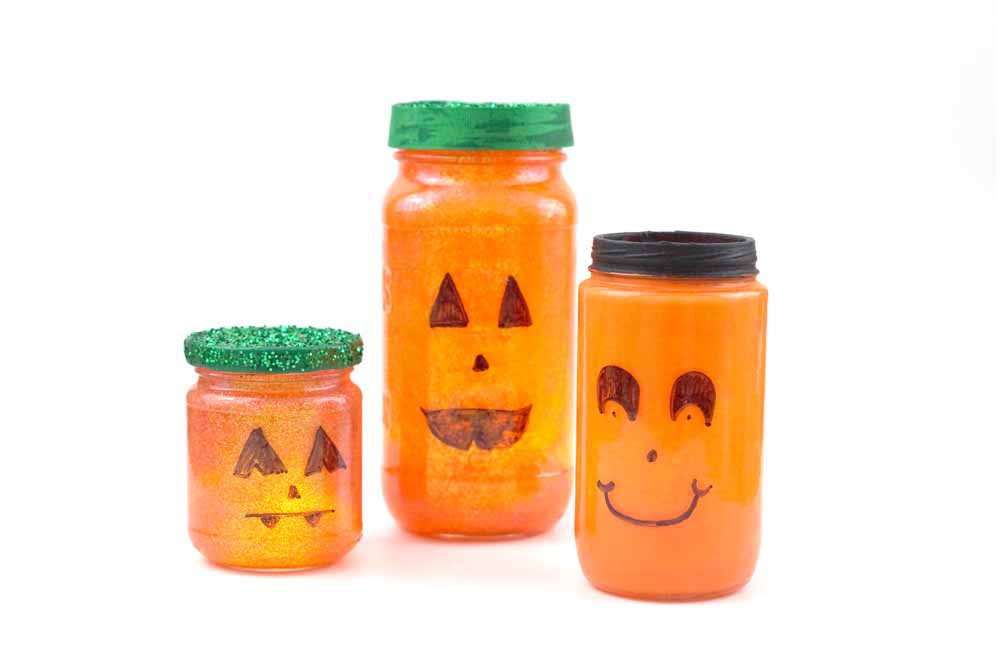 recycled jars painted like pumpkins