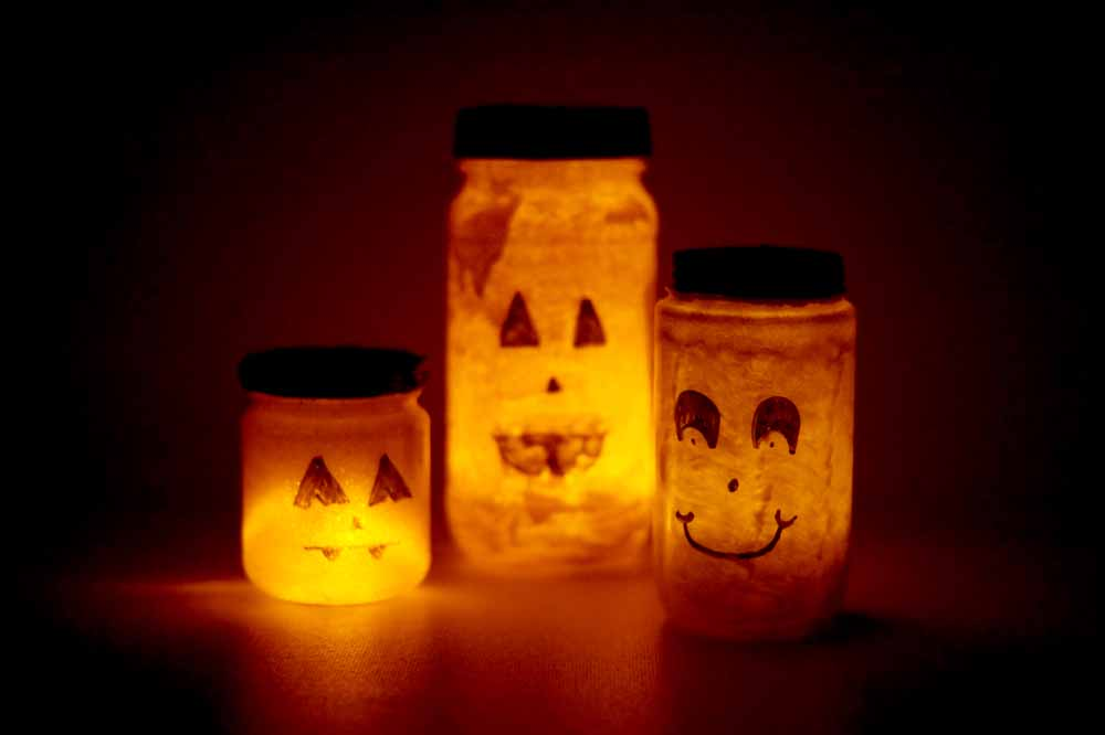 recycled jars, painted like pumpkins, lit with LED candles