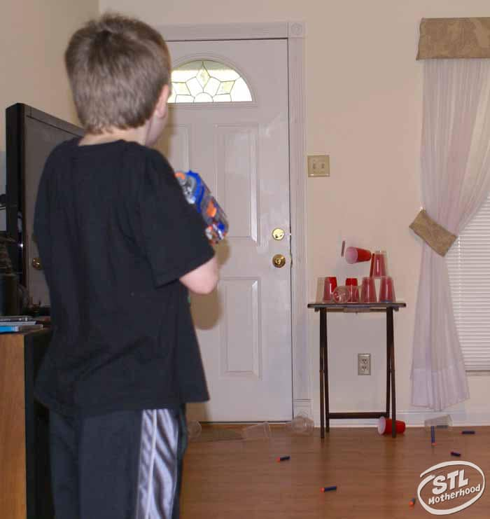 boy playing with nerf