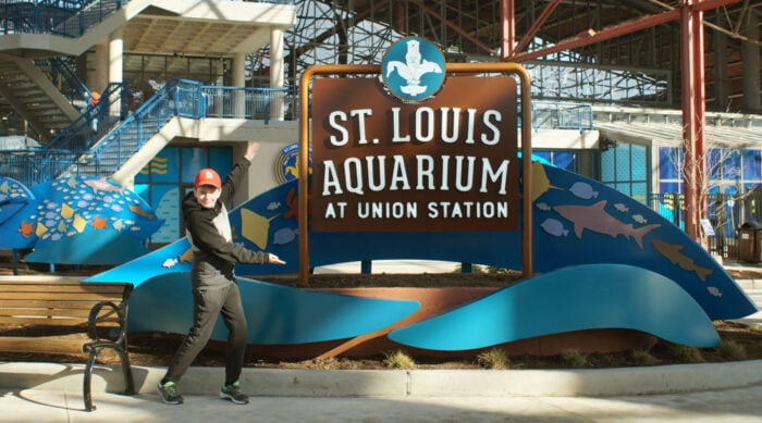 St. Louis Aquarium entrance with boy pointing at sign