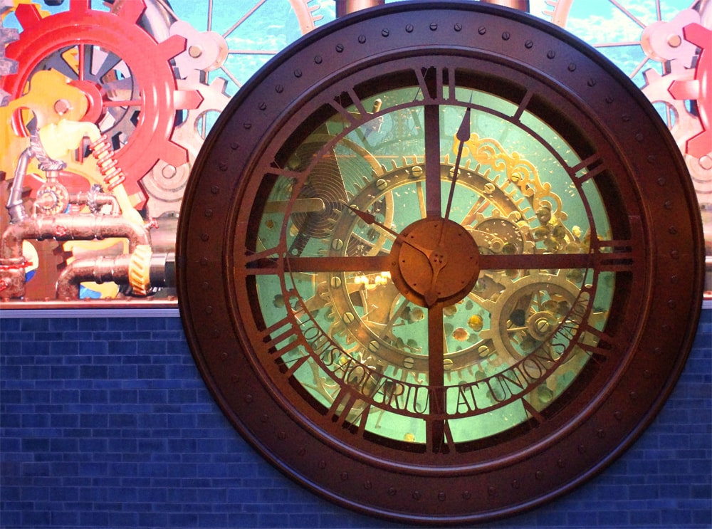 St. Louis Aquarium's clock tank filled with discus fish and a steam punk background