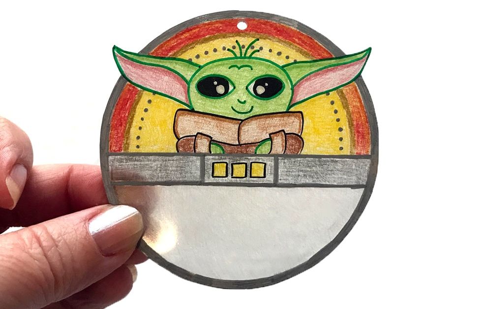 Baby Yoda shrinky dink suncatcher shows the Child in his floating bassinet.