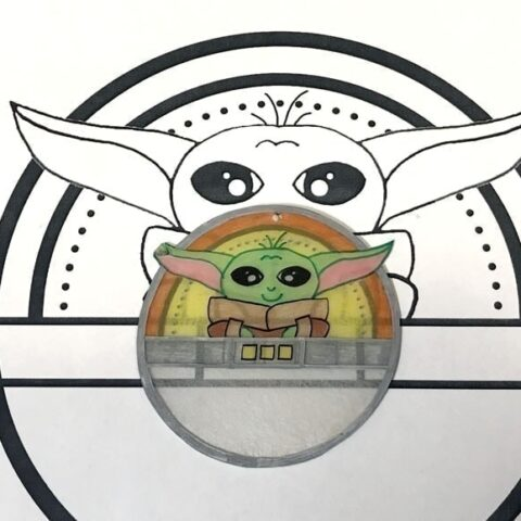 baby yoda shrinky dink shown next to drawing it was traced from