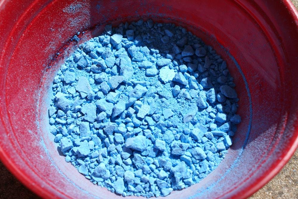 bowl of blue sidewalk chalk crushed into lumpy powder