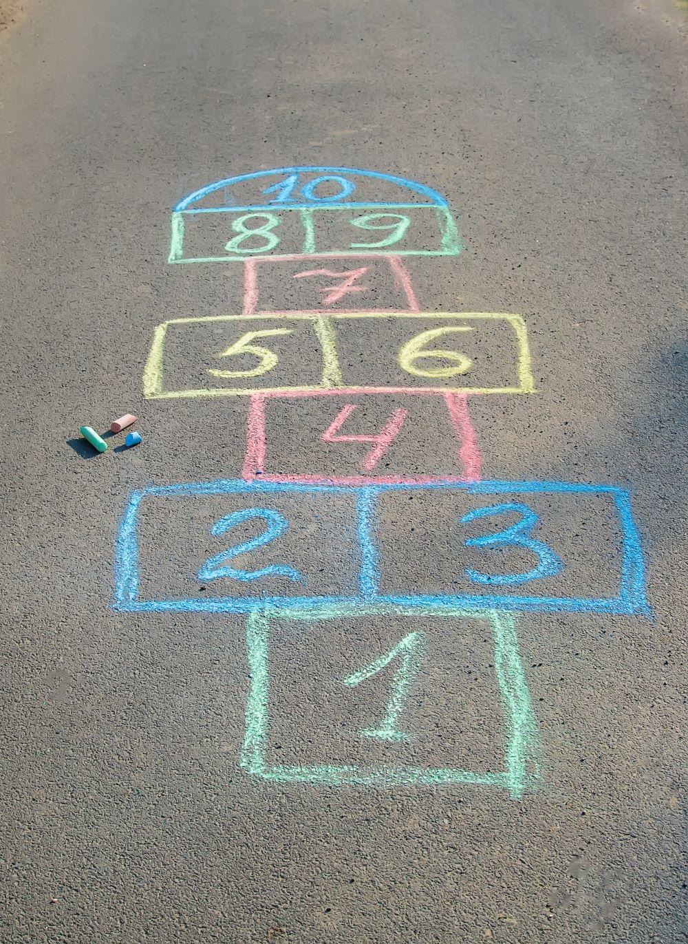 a hopscotch grid written in chalk