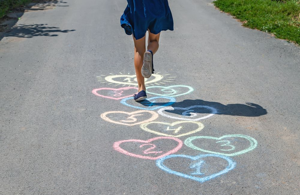 One Kid playing hopscotch
