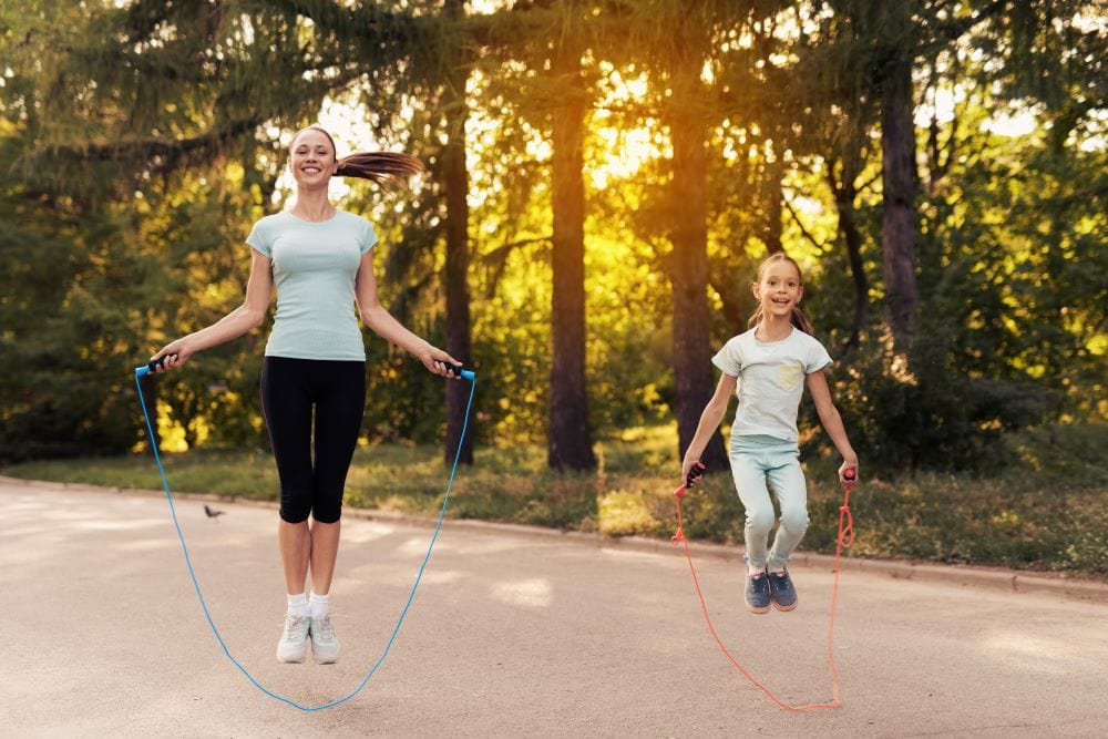 mother and daughter jump rope together