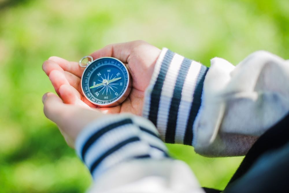 compass in boys hand