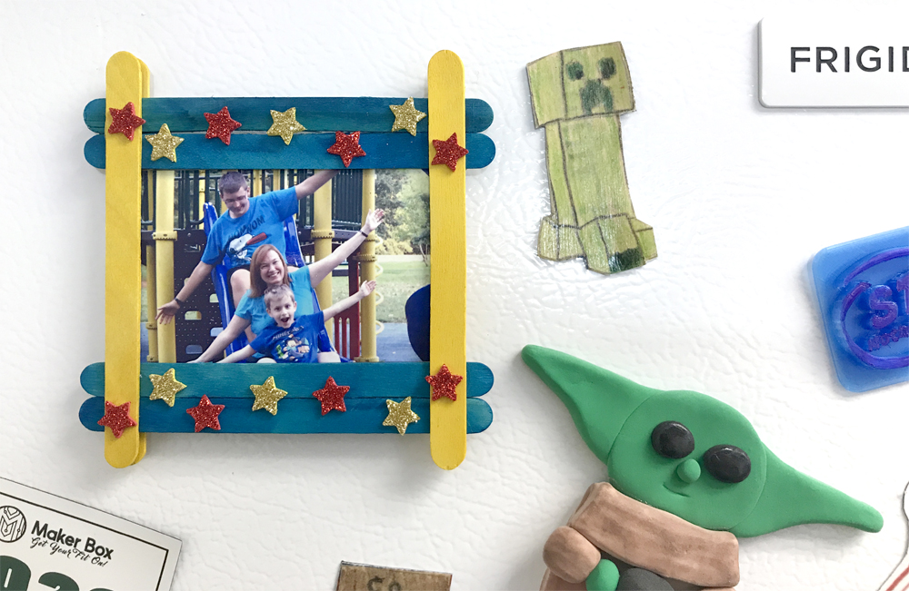 photo frame on a refrigerator made of colorful popsicle sticks and star stickers