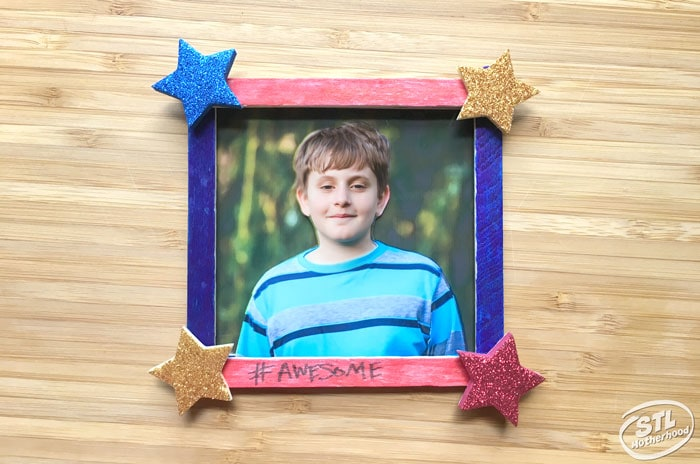 red and blue popsicle stick frame with foam stars