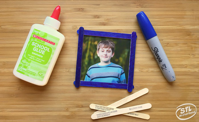 Basic supplies you need to make a popsicle stick frame: craft sticks, markers and glue