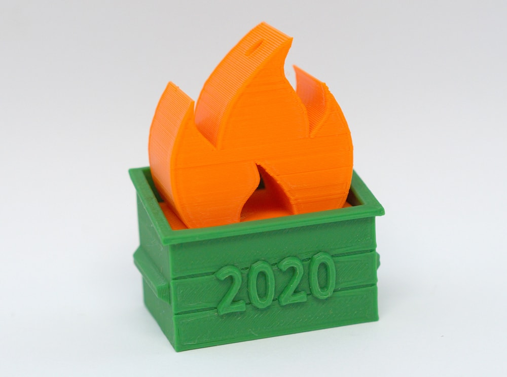 3D printed dumpster fire in orange and green