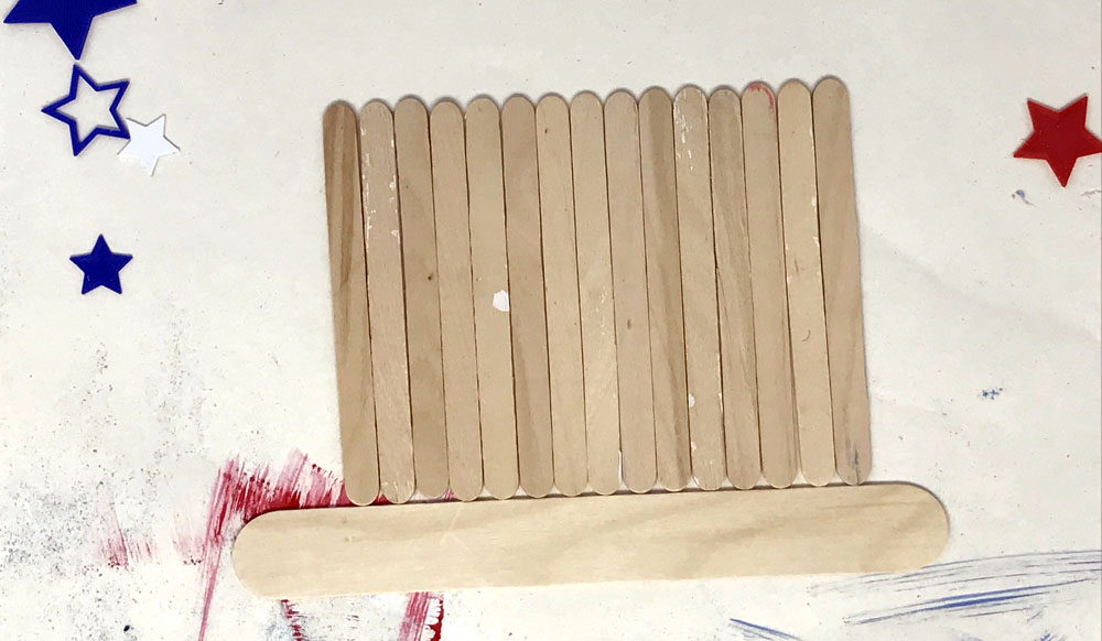 popsicle sticks lined up in a rectangle