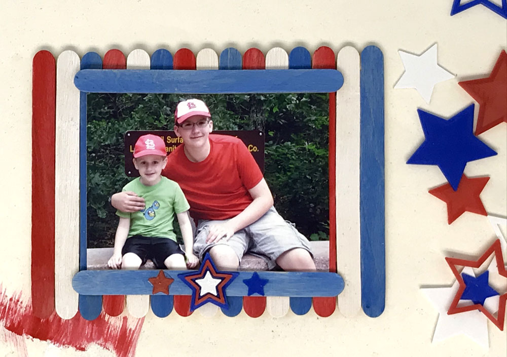 red, white and blue Popsicle stick picture frame with star accents