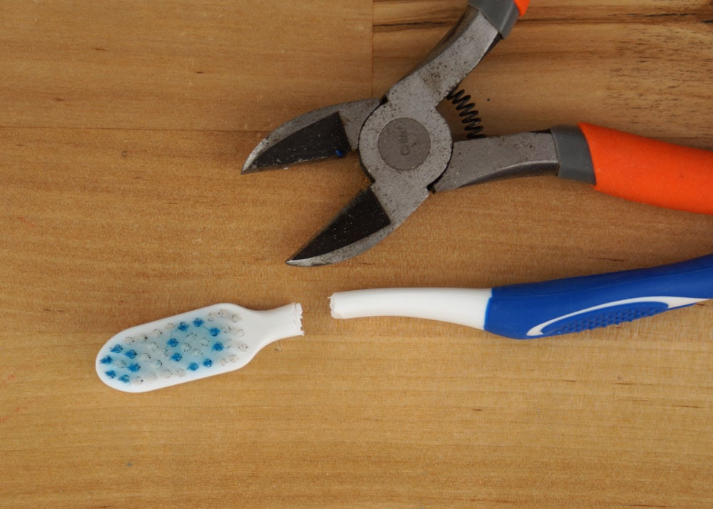 cutting the handle of a tooth brush off with snips
