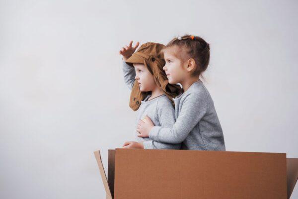 kids in a cardboard box