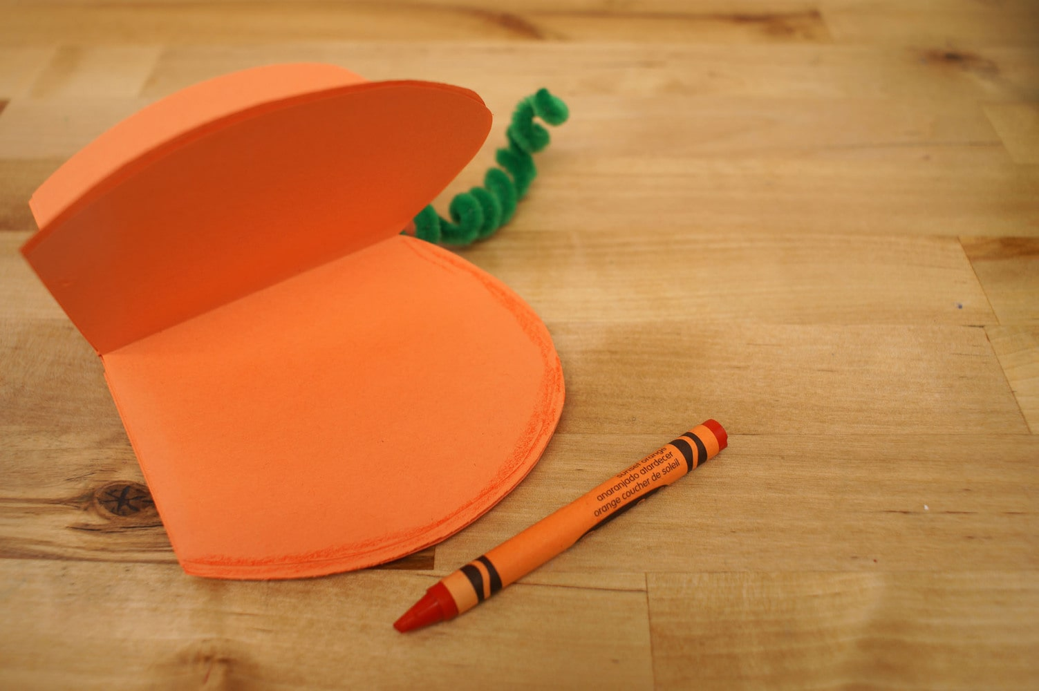 coloring in the pumpkin slices with a crayon