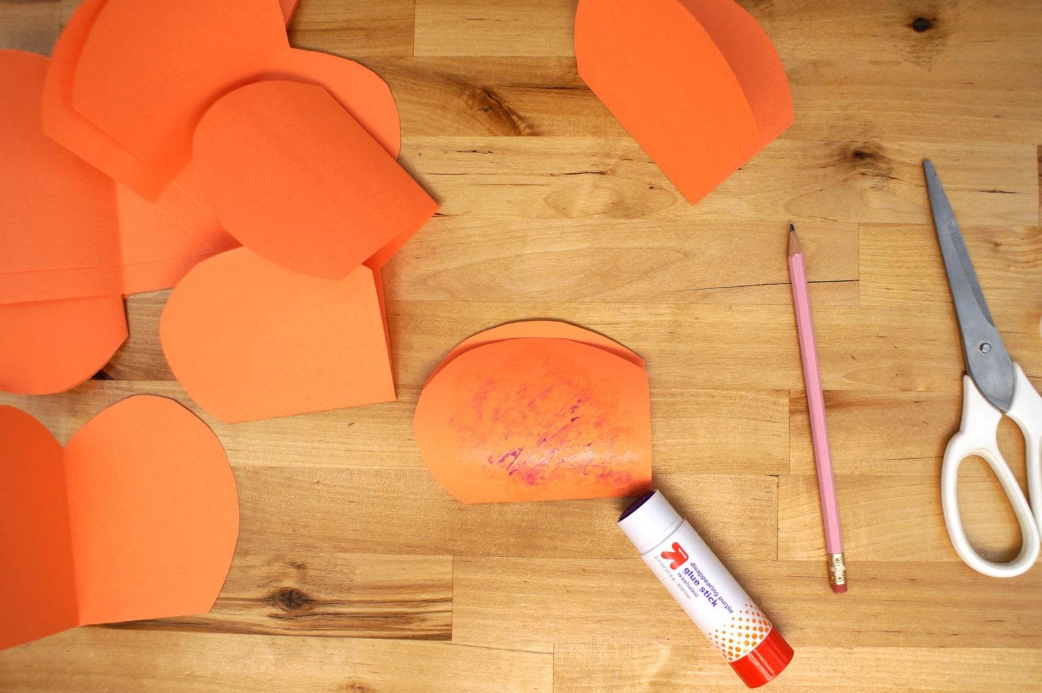 gluing paper pumpkin slices together