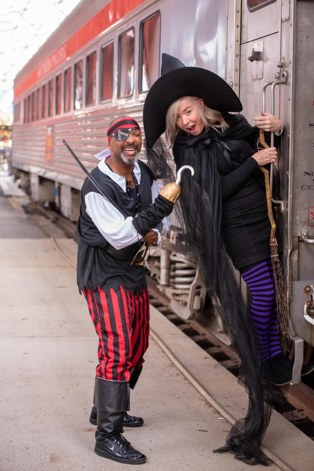 A pirate and witch ready to greet kids at Union Station for Halloween