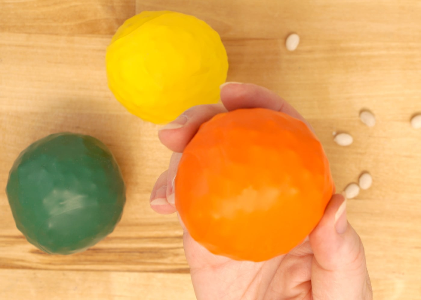 bean balls made of balloons in orange, yellow and green