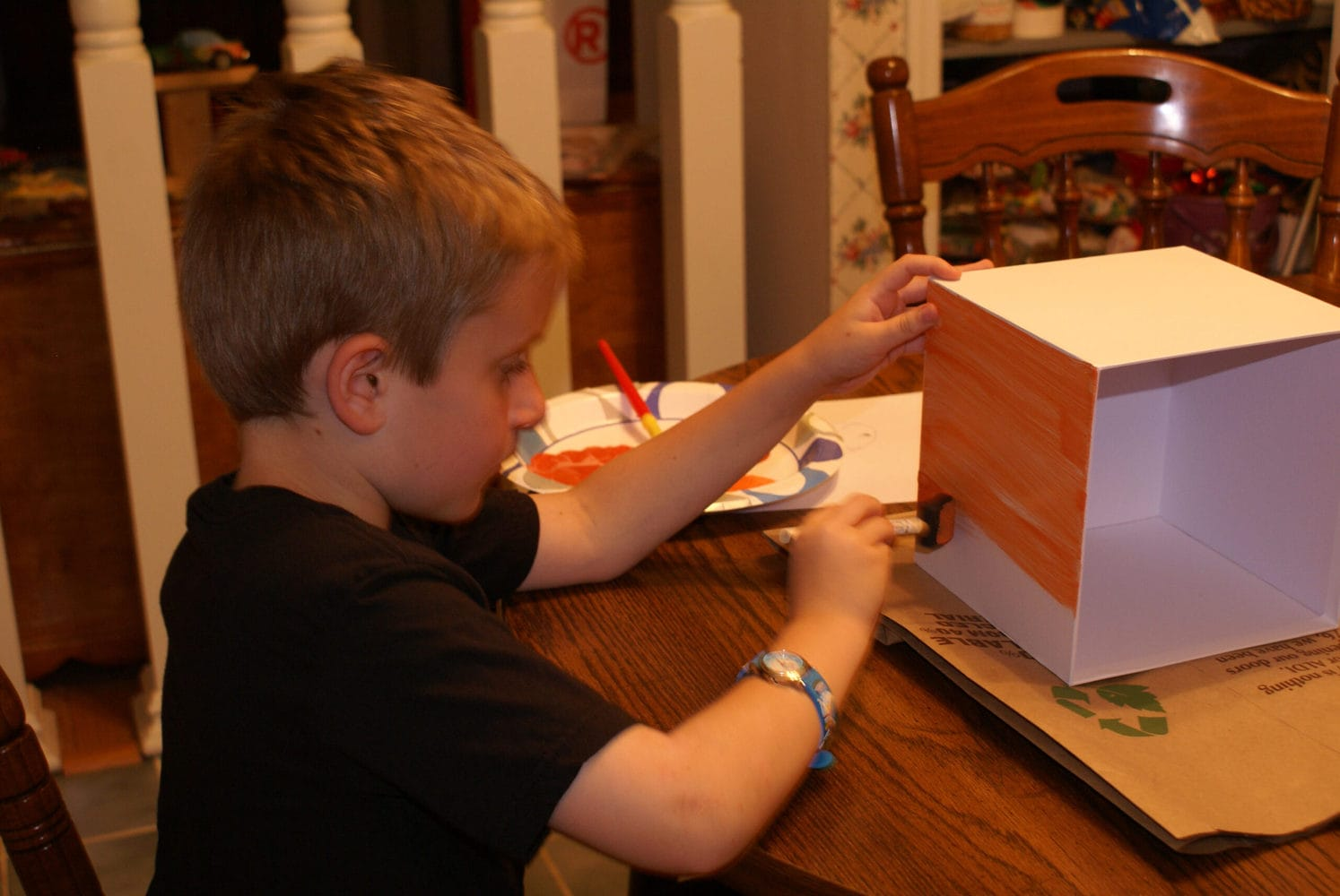 kid painting minecraft paper pumpkin