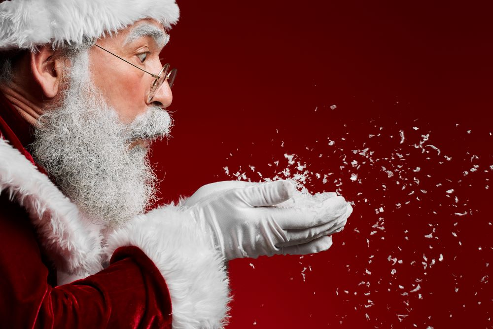 santa blowing snow from his hands