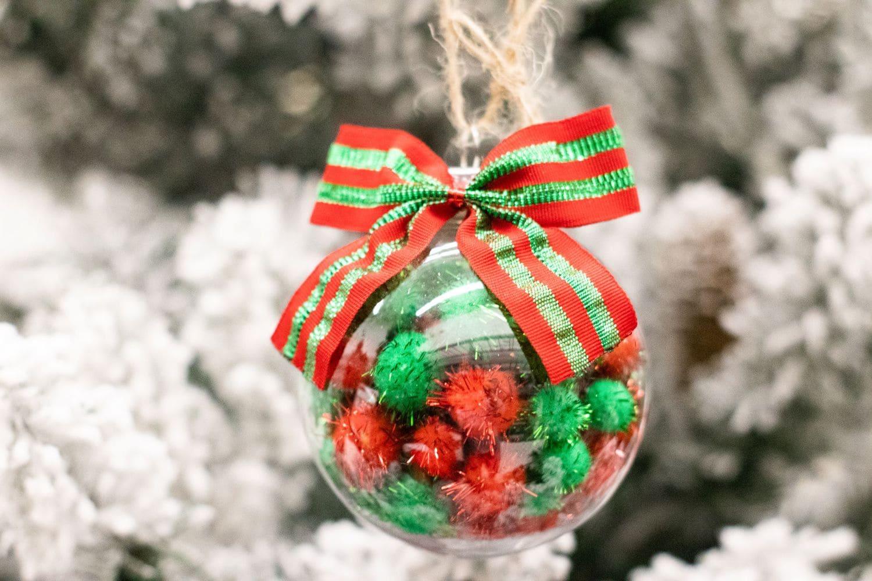 pom pom filled ornament on tree