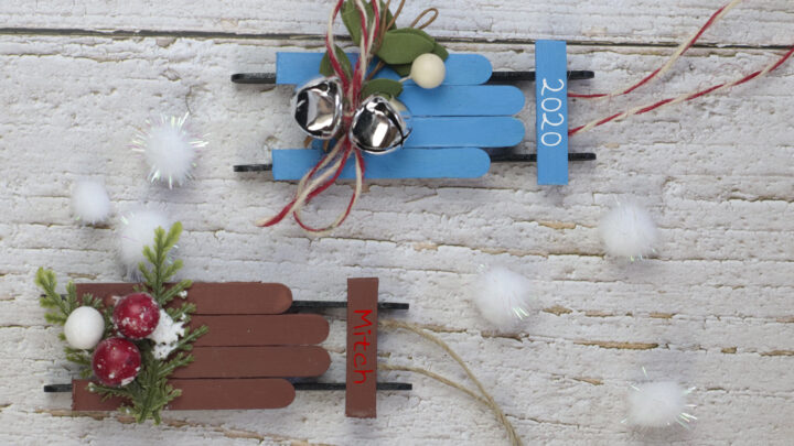 two popsicle stick sled ornaments