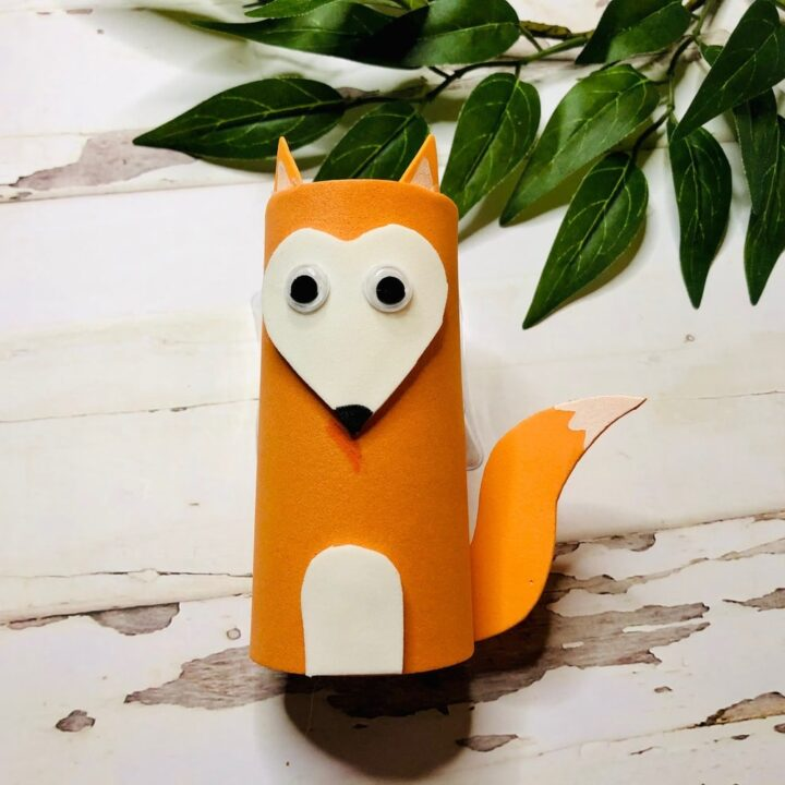 paper fox crafted from orange cardstock and a toilet paper roll