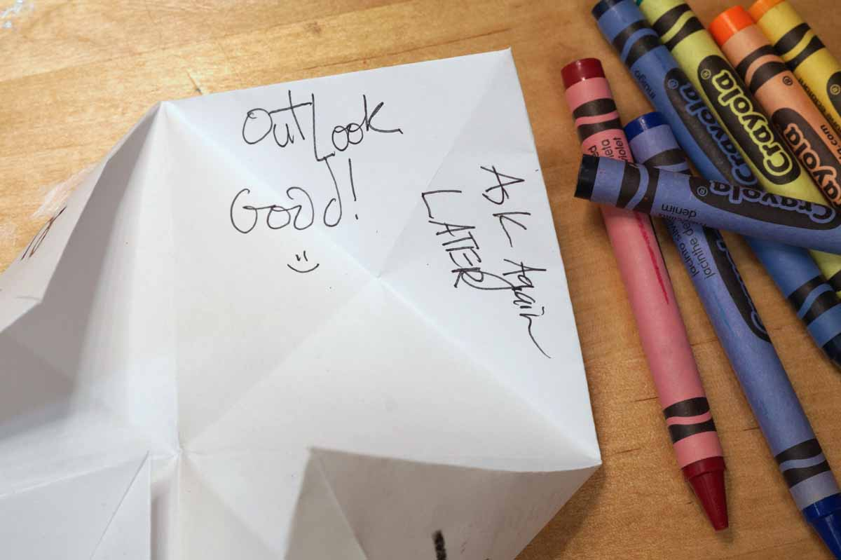 """magic 8 ball fortunes inside a paper fortune teller: this one says """"outlook good!"""" and """"ask again later"""""""