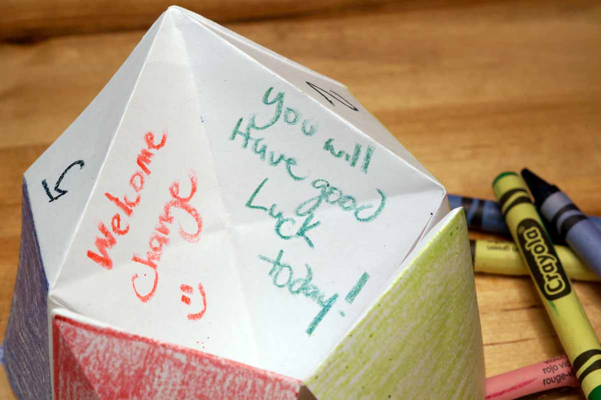 Inside a fortune teller, written in crayon: Welcome Change! and You will have Good Luck today!